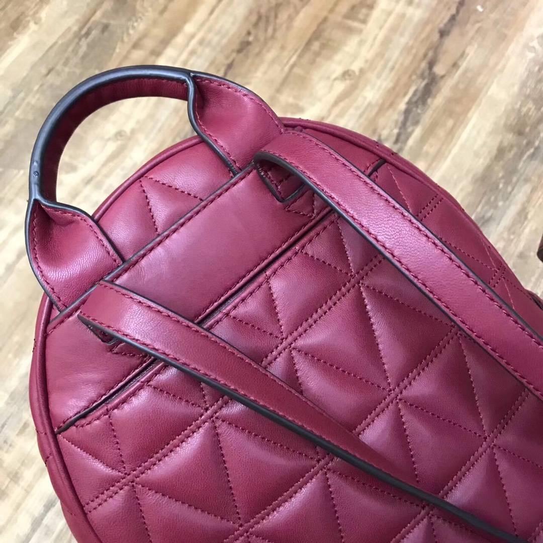 迈克科尔斯新款女包 MK羊皮三角车线铆钉双肩包女款背包书包 酒红色