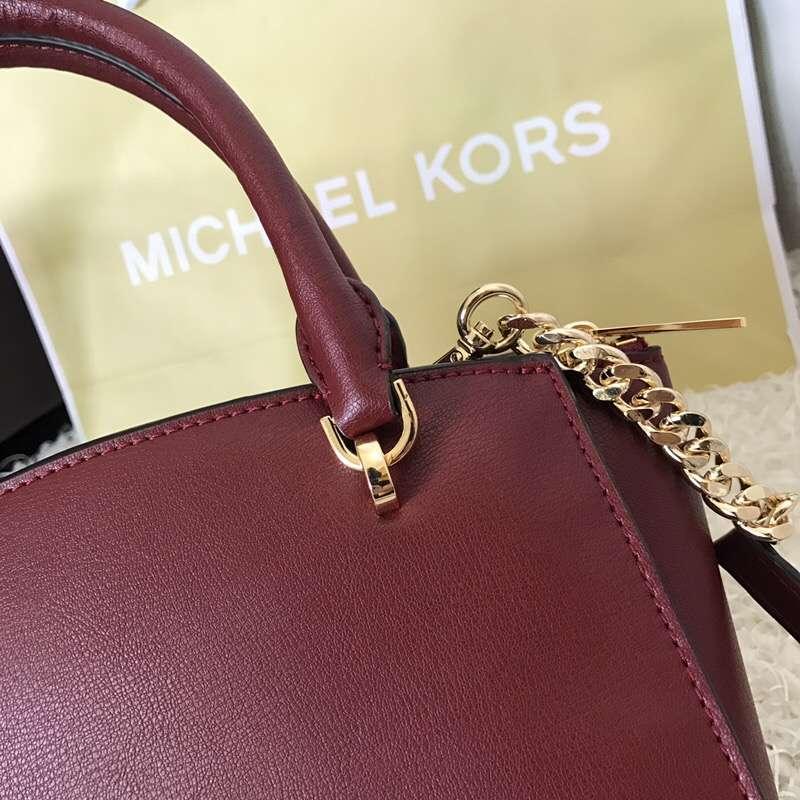 迈克科尔斯官网 MK酒红色进口手掌纹牛皮星星铆钉手提单肩斜挎女包23.5CM
